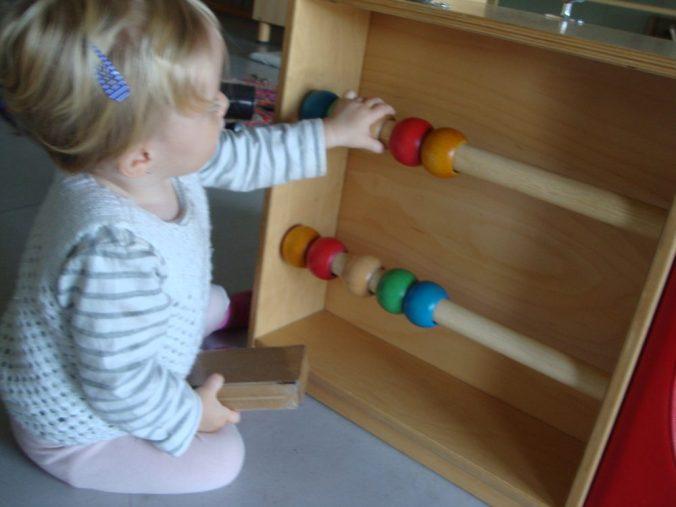 Uma juga amb les boles de fusta